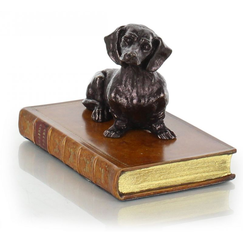 Paperweight Dachshund on a book