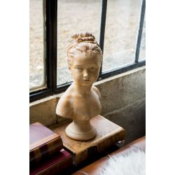 Bust of young woman wearing herhair in a bun